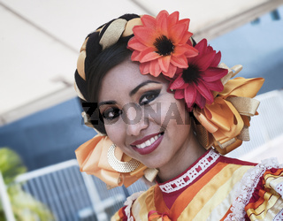 Puerto Vallarta, Mexico - April 30, 2011: Young Girl Dressed In Bright Colorful Traditional Clothing