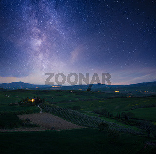 Milky Way Galaxy and Tuscany landscape