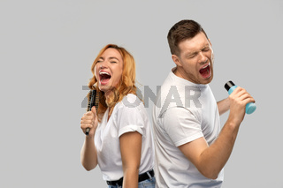 happy couple singing to hairbrush and lotion