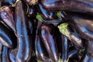 Dark purple aubergine texture background.