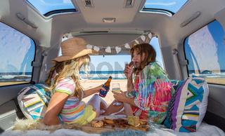 Two girls van life enjoy the beach summer