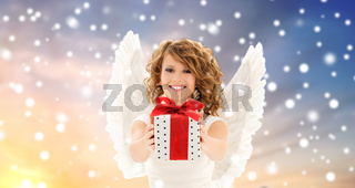 teenage girl with angel wings and christmas gift