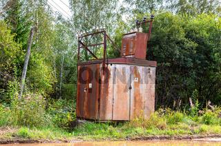 Old voltage power transformer substation at the village