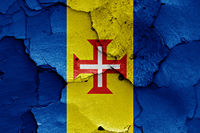 flag of Madeira painted on cracked wall