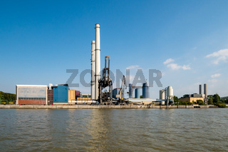 Hamburg, Germany - August 25, 2019 : View at power station Wedel and the banks of Elbe River.