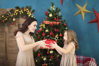 Beautiful happy mother with lher ittle daughter on the background of Christmas interior