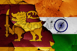 flags of Sri Lanka and India painted on cracked wall