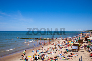 A crowd of bathers in Zelenogradsk beach located on the Baltic Sea coast, Russia.