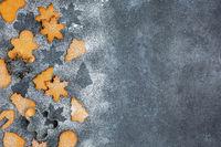 Christmas gingerbread cookies and metal cookie cutters.