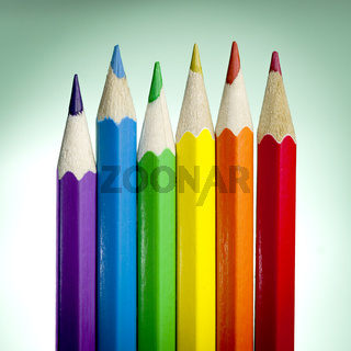 Six colored pencil with colors of the rainbow flag (or pride flag) used to represent both peace and lgbtq pride