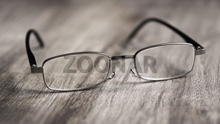reading glasses on wooden table