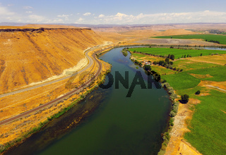 The Snake River Flows By Bluffs at Glenns Ferry Idaho