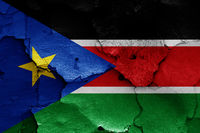 flag of South Sudan painted on cracked wall