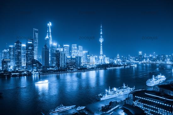 shanghai skyline at night with blue tone