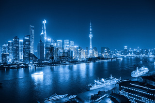 shanghai skyline at night with blue tone