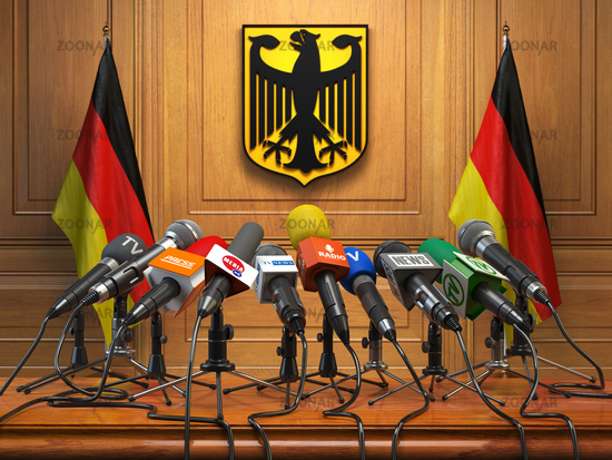 Press conference or briefing of president  or premier minister of Germany concept,. Podium speaker tribune with Germany flags and coat arms.