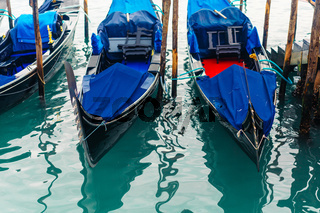 Rows of traditional wooden gondolas