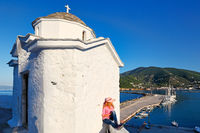 A woman at Panagitsa of Pyrgos in Skopelos, Greece