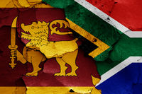 flags of Sri Lanka and South Africa painted on cracked wall