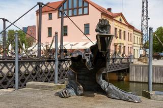The Black Ghost bronzed sculpture (designed by Svajunas Jurkus and Sergejus Plotnikovas). Danes river quay. Klaipeda Old Town residential district. Lithuania