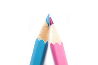 Light blue and pink pencils on white background for boy or girl announcement cards