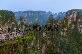 Wulingyuan, China - May 27, 2018: Tourists on pathway in Tianzi Avatar mountains nature park