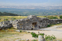 Tour groups on the ruins of Hierapolis. Tourists are shown the ruins of the ancient city.