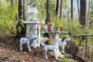 Traditional spirit house from Buddhist cosmology in forest, Thailand