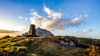 Sunset at Ticknock hill in Wicklow mountains with monument, golden hour, Ireland