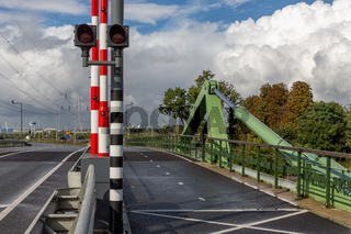Drawbridge over Dutch river Vecht with traffic lights and boom