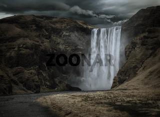 Majestic and dark Skogafoss waterfall in Iceland