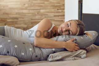 Pretty young pregnant woman sleeping