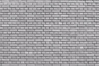 Quiet gray colored brick wall background