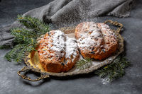 Traditional Stollen sprinkled with powdered sugar.