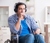Disabled man listening to music in wheelchair