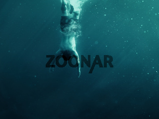 Man falling into the water. Underwater shot. Vacation, sports and active lifestyle risk concept.