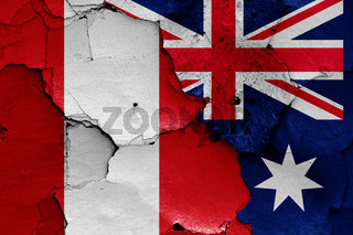 flags of Peru and Australia painted on cracked wall