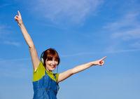 Happy woman listen music