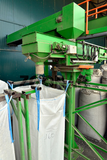 Recycled plastic waste is cut in small pieces and separated in big bags, on a recycling plant