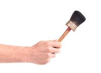 Man holding old paint brush