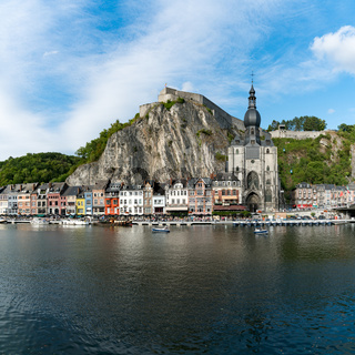 square format view of the small town of Dinant on the Maas river with the historic citadel and cathedral on the river front