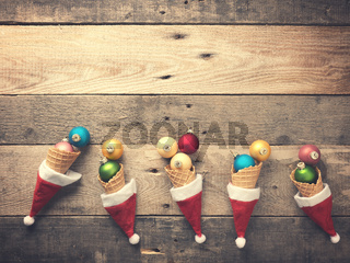 Old used Christmas baubles in an ice cream cone