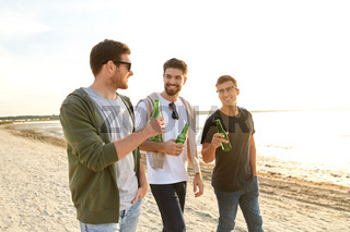 young men toasting non alcoholic beer on beach
