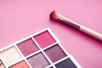 Eyeshadow palette and make-up brush on pink background, eye shadows cosmetics product as luxury beauty brand promotion and holiday fashion blog design