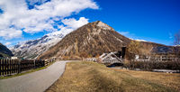 Panorama of mountain valley with stream and wooden bridge, Livingo, Italy, Alps