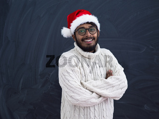 Indian man wearing traditional Santa  hat  and white sweater