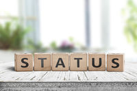 Status sign made of wood on a table