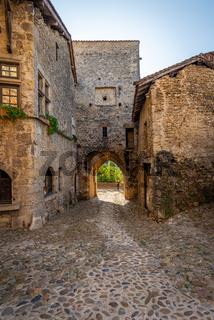 Tourist using the main city gate to enter the medieval town of P