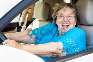 Happy Senior Woman Driving New Car