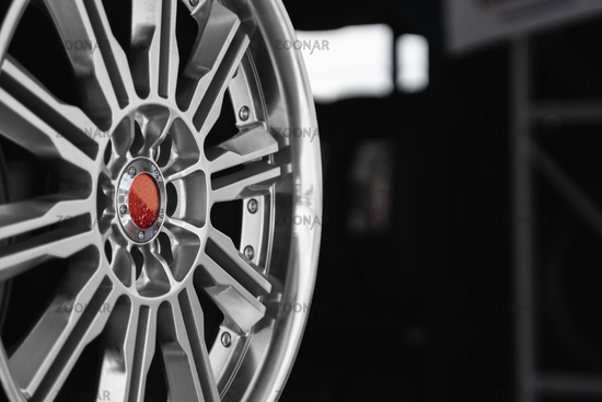 ar drives in the store with black background. Chrome car wheels for sale.